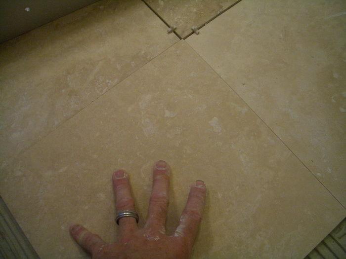 Как класть керамогранитную плитку на пол