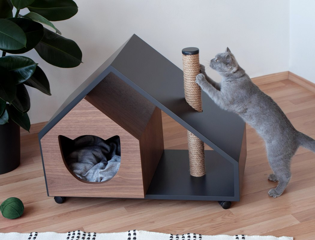 Смотрим, как оформить домик для кота под интерьер.