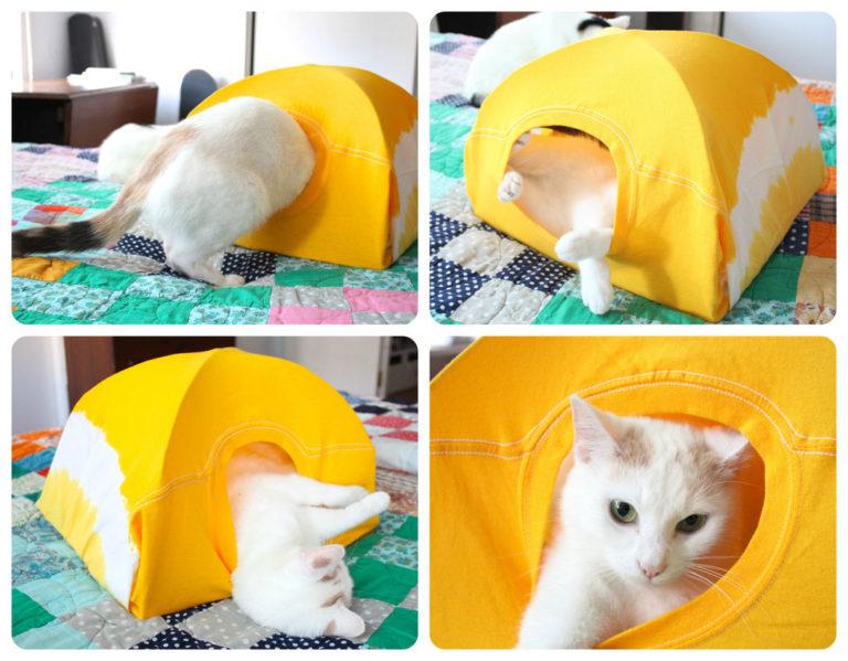 Так из коробки можно сделать домик для кота из футболки и коробки.